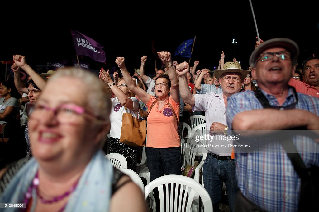 Supporters of left wing alliance party Unidos Podemos 'United We Can' cheer during the final rally ahead of Spanish General Elections on June 24, 2016 in Madrid, Spain. Spanish voters head back to the polls on June 26 after the last election in December failed to produce a government. Latest opinion polls suggest the Unidos Podemos 'United We Can' left-wing alliance could make enough gains to come in second behind the caretaker government of the center-right Popular Party.