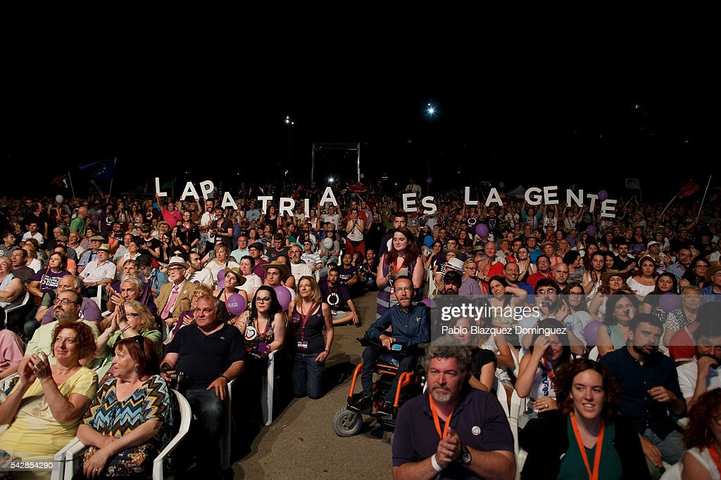 Supporters of left wing alliance party Unidos Podemos 'United We Can' hold letters 'The homeland is the people' during the final rally ahead of Spanish General Elections on June 24, 2016 in Madrid, Spain. Spanish voters head back to the polls on June 26 after the last election in December failed to produce a government. Latest opinion polls suggest the Unidos Podemos 'United We Can' left-wing alliance could make enough gains to come in second behind the caretaker government of the center-right Popular Party.