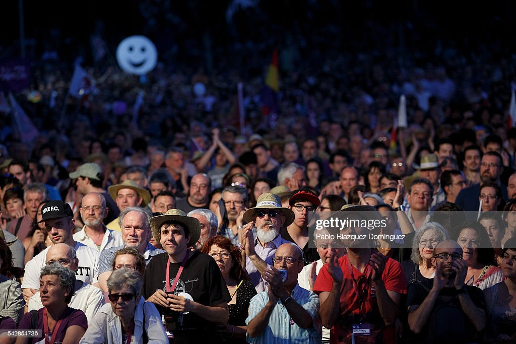 Supporters of left wing alliance party Unidos Podemos 'United We Can' watch the final rally ahead of Spanish General Elections on June 24, 2016 in Madrid, Spain. Spanish voters head back to the polls on June 26 after the last election in December failed to produce a government. Latest opinion polls suggest the Unidos Podemos 'United We Can' left-wing alliance could make enough gains to come in second behind the caretaker government of the center-right Popular Party.