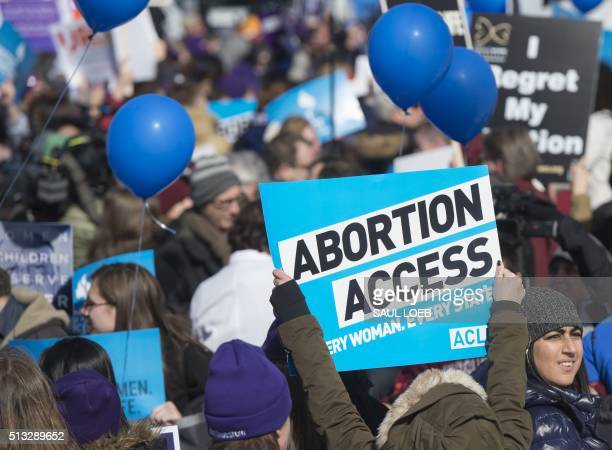 Supporters of legal access to abortion as well as antiabortion activists rally outside the Supreme Court in Washington DC March 2 as the Court hears...