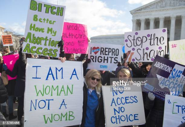 Supporters of legal access to abortion rally outside the Supreme Court in Washington DC March 2 as the Court hears oral arguments in the case of...
