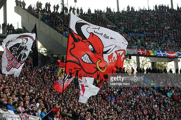 Supporters of Leipzig celebrate their team during the Bundesliga match between RB Leipzig and SV Werder Bremen at Red Bull Arena on October 23 2016...