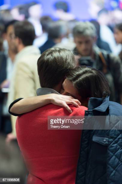 Supporters of Les Republicains candidate Francois Fillon react after projected results suggest he has been defeated in the French Presidential...