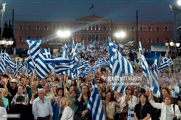 Supporters of liberalconservative New Democracy party listen to a speech delivered by the Greek Prime Minister at the Syntagma square in central...
