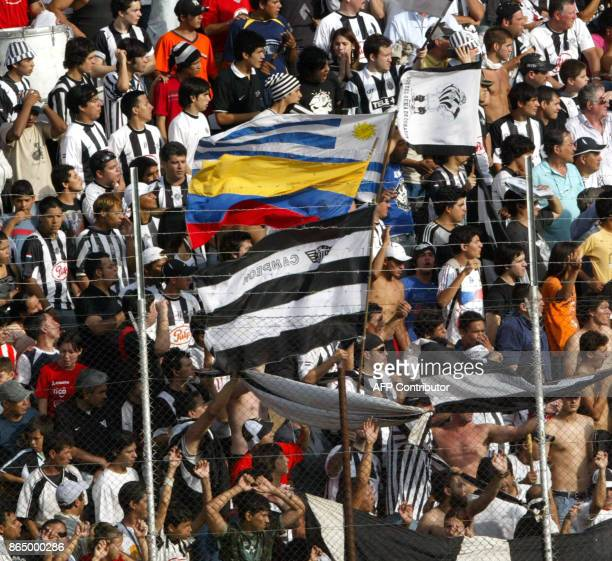 Supporters of Libertad celebrate with the Uruguayan the Colombian and the team´s flags after winning the 2007 Paraguayan closure championship 25...