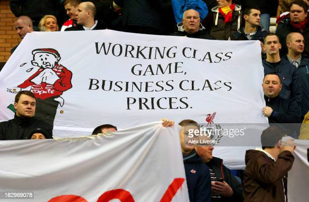 Supporters of Liverpool protest over the price of match tickets during the Barclays Premier League match between Wigan Athletic and Liverpool at the...