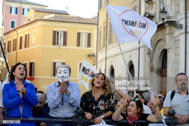 Supporters of M5S with The Guy Fawkes mask during the Demonstration against the approval of the electoral reform ' Rosatellum Bis' organised by the...