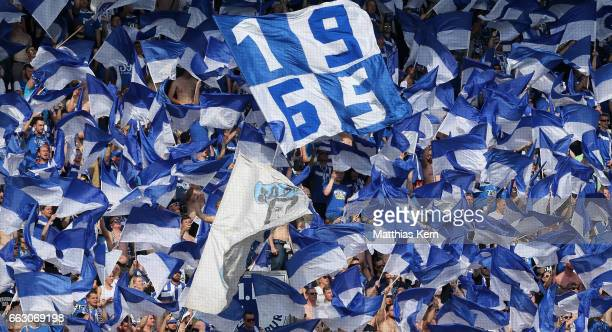 Supporters of Magdeburg celebrate their team during the third league match between 1FC Magdeburg and Rot Weiss Erfurt at MDCC Arena on April 1 2017...