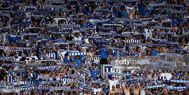 Supporters of Magdeburg cheer on their team during the Third League match between 1 FC Magdeburg and Hallescher FC at MDCCArena on August 16 2015 in...