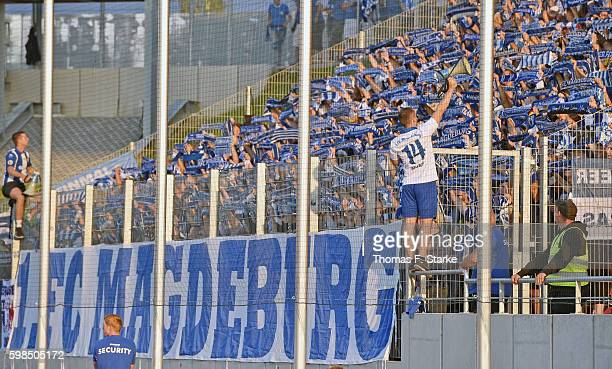 Supporters of Magdeburg cheer their team during the Third League match between FSV Zwickau and 1 FC Magdeburg at Stadion Zwickau on September 1 2016...