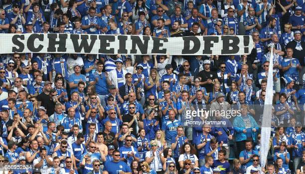 Supporters of Magdeburg show a banner called 'Schweine DFB' during the Third League match between 1 FC Magdeburg and Sportfreunde Lotte at MDCCArena...