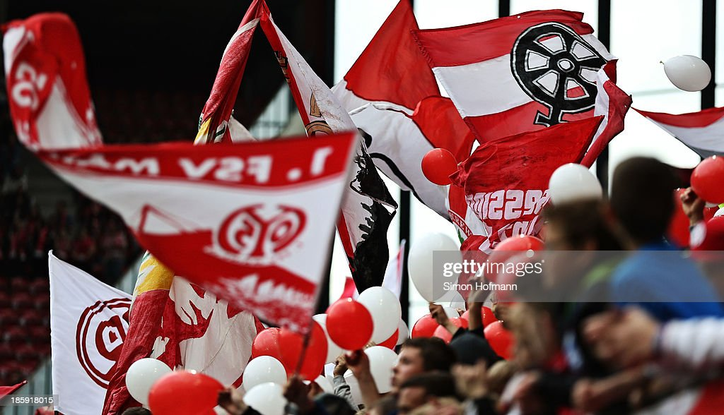 Supporters of Mainz wave their flags during the Bundesliga match between 1. FSV Mainz and Eintracht Braunschweig at Coface Arena on October 26, 2013 in Mainz, Germany.