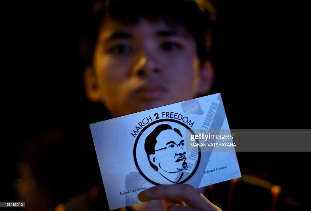 Supporters of Malaysian opposition leader, <a gi-track='captionPersonalityLinkClicked' href=/galleries/search?phrase=Anwar+Ibrahim&family=editorial&specificpeople=600601 ng-click='$event.stopPropagation()'>Anwar Ibrahim</a> take part in a candle-light vigil outside the Sungai Buloh Prison, on the outskirts of Kuala Lumpur on February 11, 2015. The family of jailed Malaysian opposition leader <a gi-track='captionPersonalityLinkClicked' href=/galleries/search?phrase=Anwar+Ibrahim&family=editorial&specificpeople=600601 ng-click='$event.stopPropagation()'>Anwar Ibrahim</a> described his five-year incarceration as an 'outrage' and vowed an international campaign to free the former deputy prime minister.