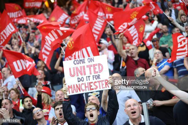 Supporters of Manchester United cheer prior to the UEFA Europa League final football match Ajax Amsterdam v Manchester United on May 24 2017 at the...