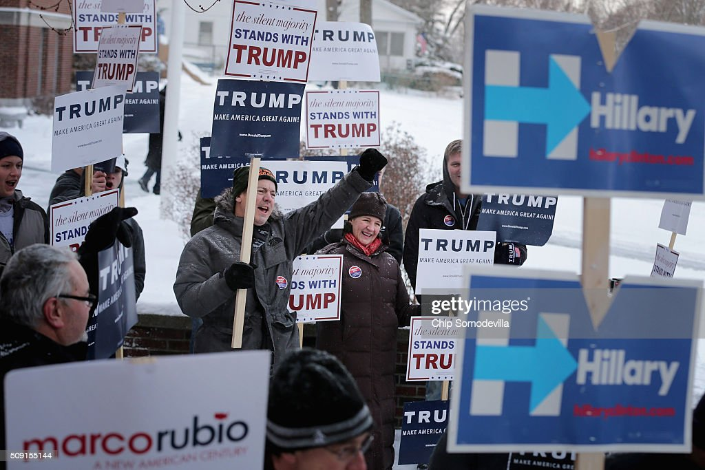 Supporters of many of the presidential candidates hold signs outside the polling place at the Webster School February 9, 2016 in Manchester, New Hampshire. Tuesday is the 100th anniversary of the New Hampshire primariy, the 'First in the Nation' test for presidential candidates from both parties.
