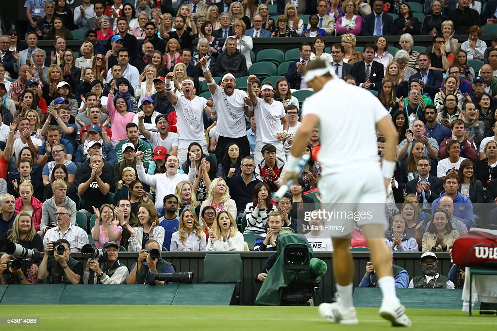 Supporters of <a gi-track='captionPersonalityLinkClicked' href=/galleries/search?phrase=Marcus+Willis+-+Tennis+Player&family=editorial&specificpeople=16082201 ng-click='$event.stopPropagation()'>Marcus Willis</a> celebrate in centre court during the Men's Singles second round match between <a gi-track='captionPersonalityLinkClicked' href=/galleries/search?phrase=Marcus+Willis+-+Tennis+Player&family=editorial&specificpeople=16082201 ng-click='$event.stopPropagation()'>Marcus Willis</a> of Great Britain and Roger Federer of Switzerland on day three of the Wimbledon Lawn Tennis Championships at the All England Lawn Tennis and Croquet Club on June 29, 2016 in London, England.