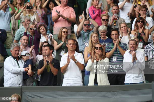 Supporters of Martina Hingis of Switzerland and Jamie Murray of Great Britain in the family box during the Mixed Doubles Final on Center Court during...
