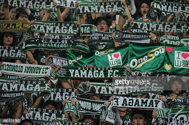 Supporters of Matsumoto Yamaga hold mufflers prior to the JLeague match between FC Tokyo and Matsumoto Yamaga FC at Ajinomoto Stadium on September 26...