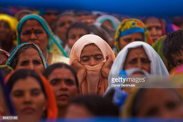 Supporters of Mayawati Kumari of the Bahujan Samaj Party and Chief Minister of Uttar Pradesh state listen to her speech during a political rally on...