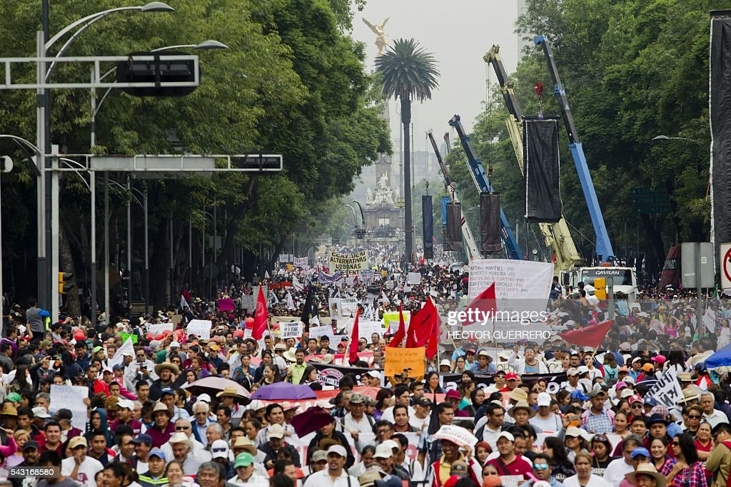 Supporters of Mexican leader of the National Regeneration Movement, Andres Manuel Lopez Obrador, protest in support of the National Coordination of Education Workers (CNTE) teachers' union, and against an education reform launhced by the government along Reforma Avenue in Mexico City on June 26, 2016. / AFP / Hector GUERRERO
