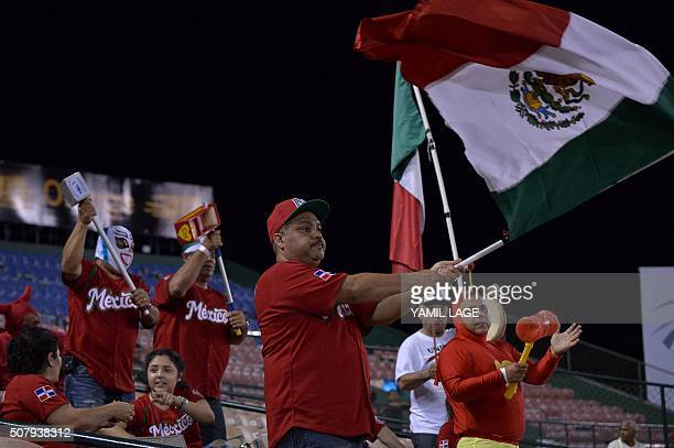 Supporters of Mexico cheer for their team during the 2016 Caribbean baseball series game againsT Dominican Republic on February 1 2016 in Santo...
