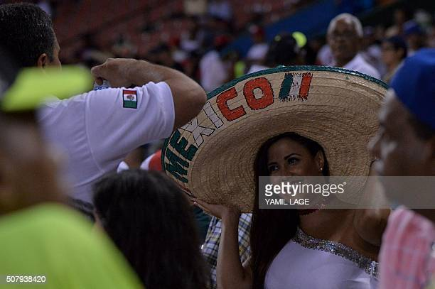 Supporters of Mexico cheer for their team during the 2016 Caribbean baseball series game agains Dominican Republic on February 1 2016 in Santo...