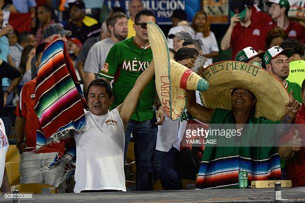 Supporters of Mexico cheer for their team during their 2016 Caribbean baseball series game against Venezuela on February 3 2016 in Santo Domingo AFP...