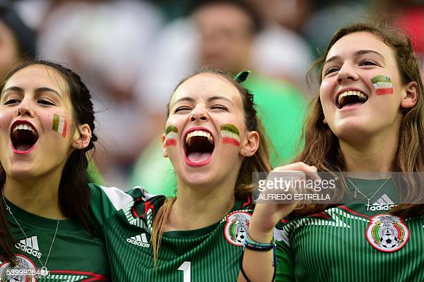 TOPSHOT Supporters of Mexico wait for the start of the Copa America Centenario football tournament match against Venezuela in Houston Texas United...
