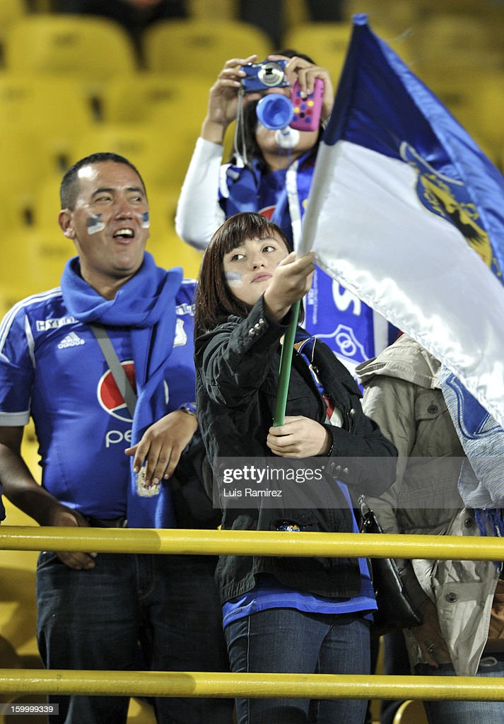 Supporters of Millonarios cheer their team during a match between Millonarios and Independiente Santa Fe as part of the Superliga Postobon 2013 at the Nemesio Camacho Stadium on January 24, 2013 in Bogota, Colombia.