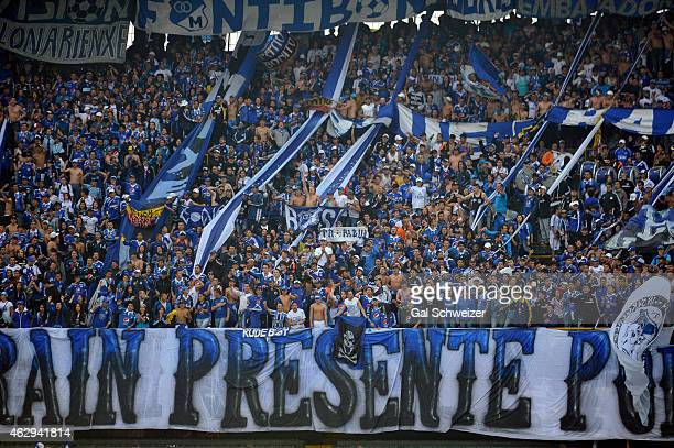 Supporters of Millonarios cheer their team during a match between Millonarios and Patriotas FC as part of second round of Liga Aguila 2015 at Nemesio...
