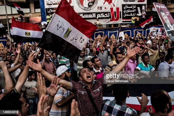 Supporters of Mohamed Morsi the Muslim Brotherhood's candidate protest against Egypt's military rulers in Tahrir Square and celebrate a premature...