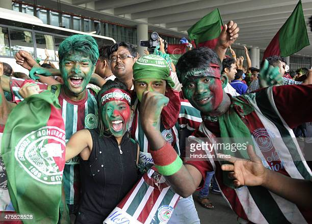 Supporters of Mohun Bagan Athletic Club celebrate on the team's arrival after winning I League title at the club lawn on June 1 2015 in Kolkata India...