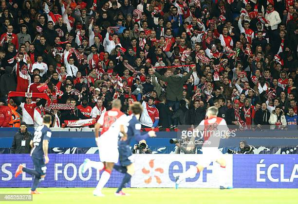 Supporters of Monaco cheer for their team during the French Cup match between Paris SaintGermain FC and AS Monaco FC at Parc des Princes stadium on...