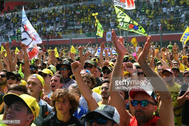 Supporters of Movistar Yamaha's Italian rider Valentino Rossi cheer during the Moto GP Grand Prix at the Mugello race track on June 4 2017 Ducati's...