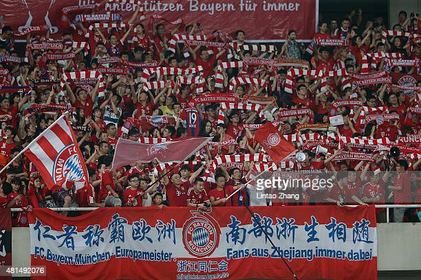 Supporters of Muenchen celebrate during the international friendly match between FC Bayern Muenchen and Inter Milan of the Audi Football Summit 2015...