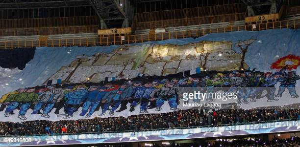 Supporters of Napoli during the UEFA Champions League Round of 16 second leg match between SSC Napoli and Real Madrid CF at Stadio San Paolo on March...