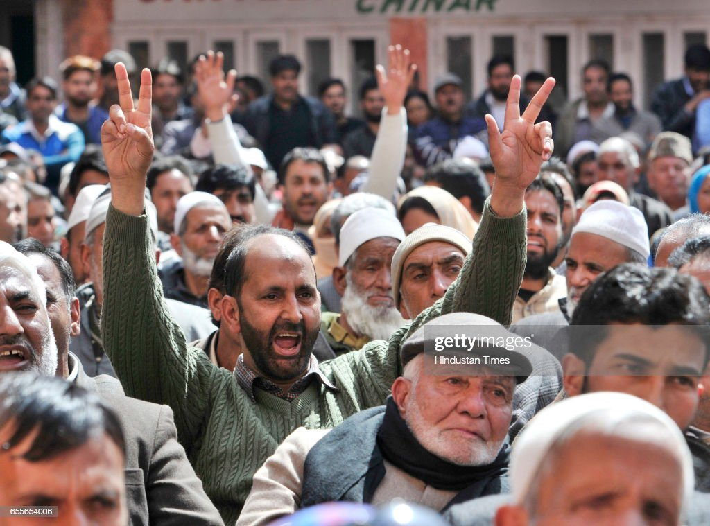 Supporters of National Conference and Congress shout slogans during an election rally addressed by National Conference Patron and President Farooq Abdullah after filling his nomination paper for parliamentary elections on March 20, 2017 in Srinagar, India.