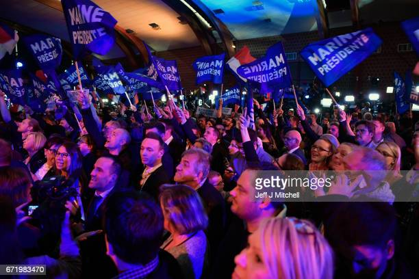 Supporters of National Front leader Marine Le Pen cheer in celebration in the Espace Francios Mitterrand on April 23 2017 in Henin Beaumont France...
