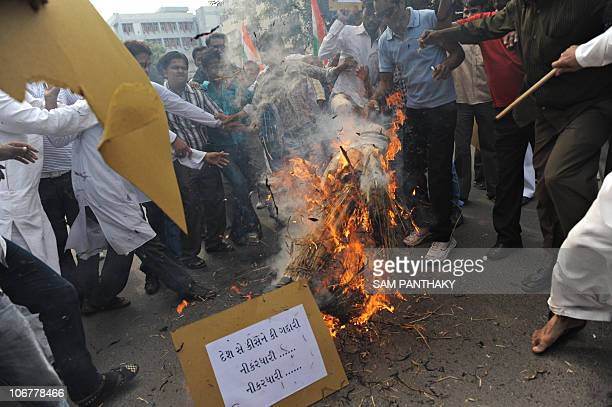 Supporters of National Students' Union of India burn the effigy of Rashtriya Swayamsevak Sangh former chief KS Sudarshan during a protest in...