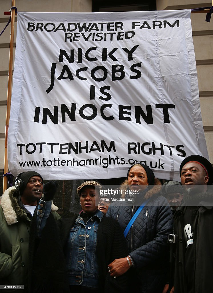 Supporters of Nicolas Jacobs, who is accused of the murder of PC (Police Constable) Keith Blakelock, protest outside the Old Bailey on March 3, 2014 in London, England. PC Blakelock was murdered by a mob during rioting at the Broadwater Farm housing estate in Tottenham, north London in 1985.