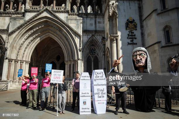 Supporters of Noel Conway from the campaign group Dignity in Dying demonstrate next to a counter protest from the group Distant Voices who oppose the...