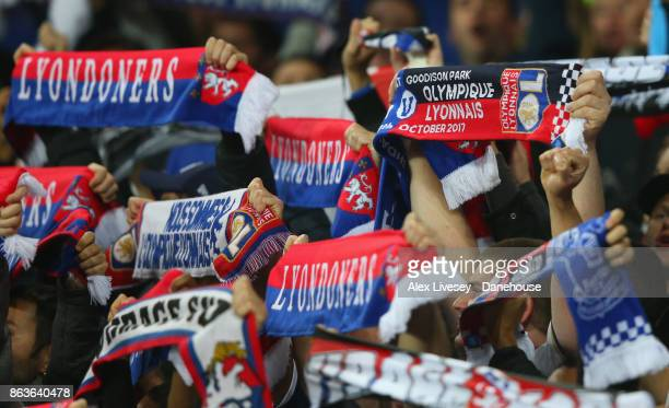 Supporters of Olympique Lyon hold scarves aloft during the UEFA Europa League group E match between Everton FC and Olympique Lyon at Goodison Park on...