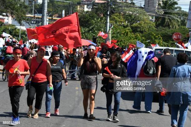 Supporters of opposition candidate Salvador Nasralla head to a demonstration in Tegucigalpa on December 10 2017 The protests that have been ongoing...