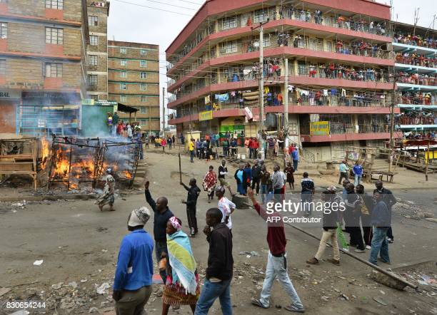 Supporters of opposition coalition National Super Alliance leader set up burning barricades in the Nairobi slum of Mathare on August 12 2017...