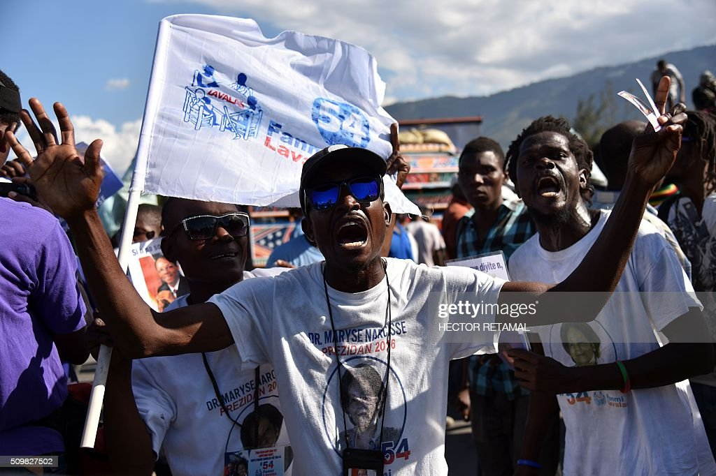 Supporters of opposition party Fanmi Lavalas protest in front of Haitian Parliament, during a march in Port-au-Prince, on February 12, 2016, to ask for Jocelerme Privert, current president of the senate to take the provisional presidency of Haiti for a period of two years. Election for a provisonal president will be held on Saturday 13th by the National Assembly and installation is scheduled on Sunday 14th. / AFP / HECTOR RETAMAL