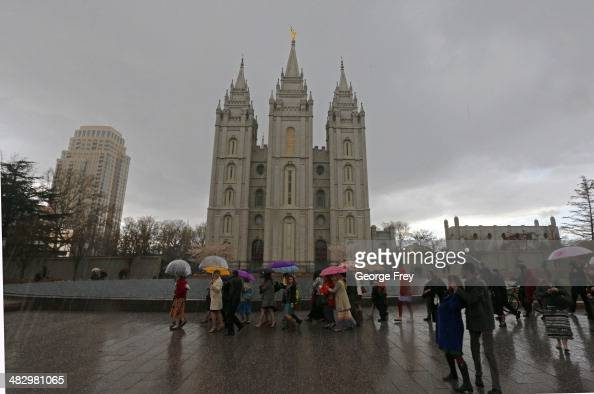 500 supporters of 'Ordain Women' walk past the Salt Lake Temple of the Mormon church to march to Temple Square on April 5 2014 in Salt Lake City Utah...