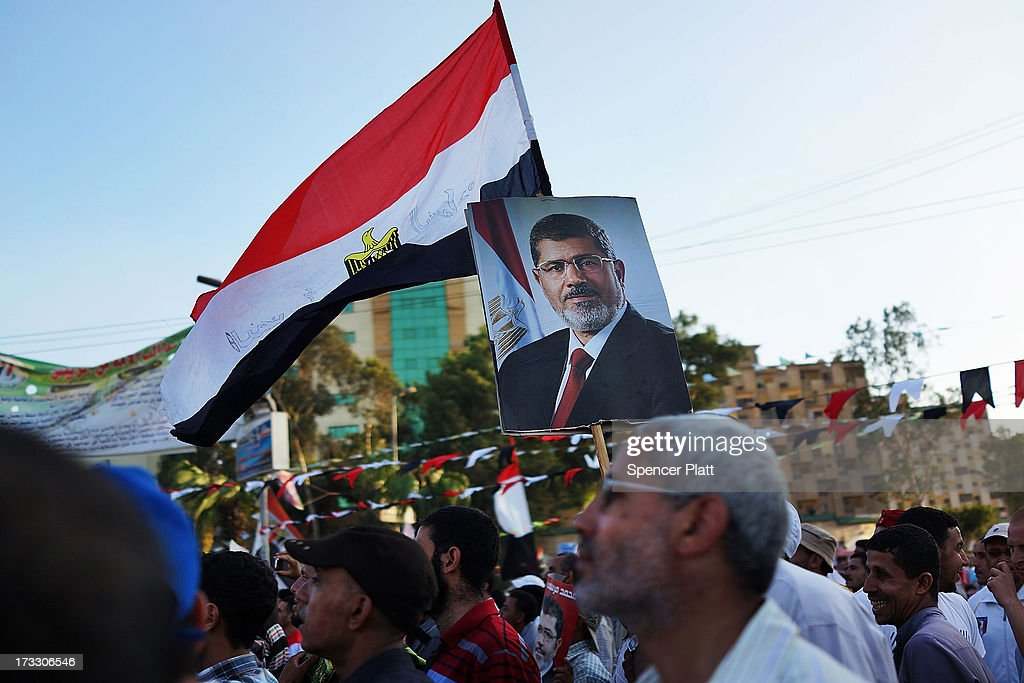 Supporters of ousted president Mohamed Morsi attend a rally before breaking the daily Ramadan fast on the second day of Ramadan, the sacred holy month for Muslims where many will fast from sun-up to sun-down on July 11, 2013 in Cairo, Egypt. Egypt continues to be in a state of political paralysis following the ousting of former President and Muslim Brotherhood leader Mohamed Morsi by the military. Adly Mansour, chief justice of the Supreme Constitutional Court, was sworn in as the interim head of state in a ceremony in Cairo on the morning of July 4.
