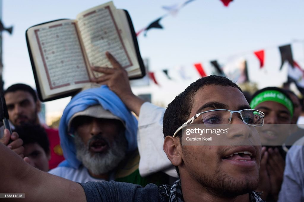 Supporters of ousted president Mohamed Morsi attend a rally before breaking the daily Ramadan fast on the second day of Ramadan the sacred holy month...