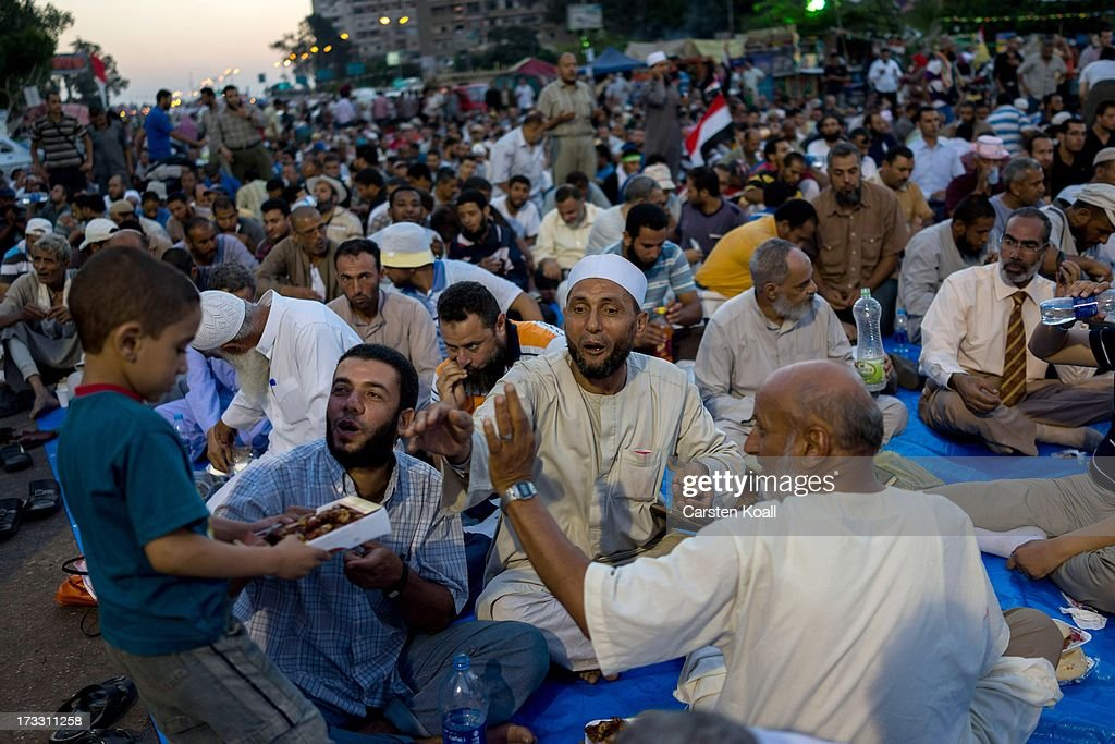 Supporters of ousted president Mohamed Morsi break their daily Ramadan fast on the second day of Ramadan, the sacred holy month for Muslims where many will fast from sun-up to sun-down on July 11, 2013 in Cairo, Egypt. Egypt continues to be in a state of political paralysis following the ousting of former President and Muslim Brotherhood leader Mohamed Morsi by the military. Adly Mansour, chief justice of the Supreme Constitutional Court, was sworn in as the interim head of state in a ceremony in Cairo on the morning of July 4.