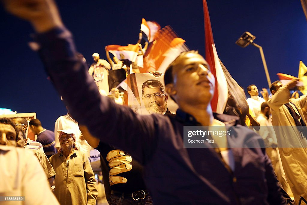 Supporters of ousted president Mohamed Morsi demonstrate in the street after the evening Friday prayer on the third day of Ramadan, the sacred holy month for Muslims where many will fast from sun-up to sun-down on July 12, 2013 in Cairo, Egypt. Egypt continues to be in a state of political paralysis following the ousting of former President and Muslim Brotherhood leader Mohamed Morsi by the military. Adly Mansour, chief justice of the Supreme Constitutional Court, was sworn in as the interim head of state in a ceremony in Cairo on the morning of July 4.